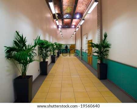 Corporate White and Yellow Hallway with Plants - stock photo