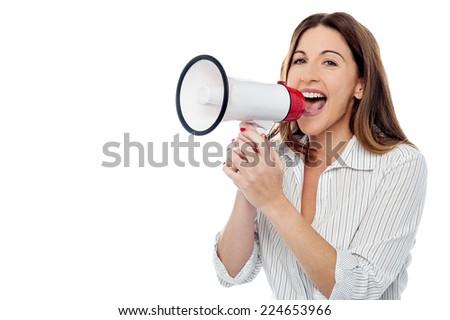 Corporate woman announcing through a megaphone  - stock photo
