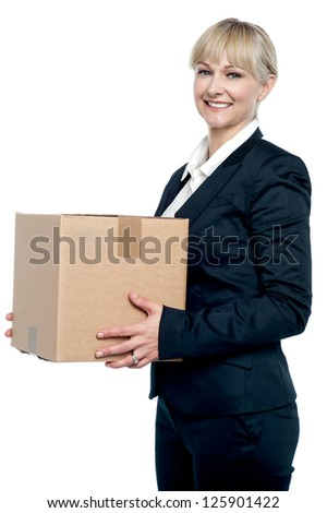 Corporate woman with a cardboard box in hand. Shifting her office. - stock photo
