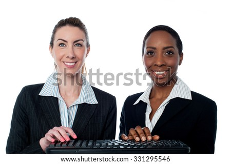 Corporate women using keyboard together