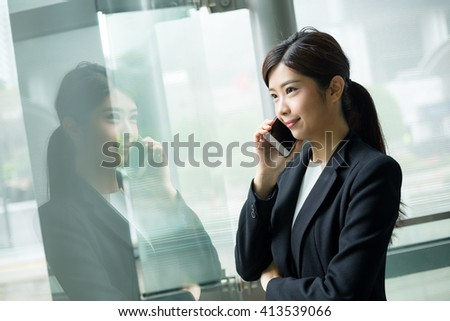 Corporate worker talking on mobile phone - stock photo
