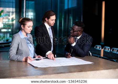 Corporates discussing the business plan in meeting room. - stock photo