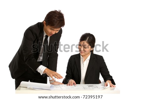 Corportate people discussing building plans - stock photo