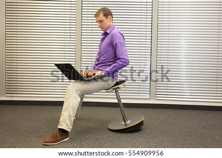 correct position during office work - man sitting on pneumatic stool working with laptop in  sc 1 st  Shutterstock & Text Neck Man Slouching Position Sitting Stock Photo 411950728 ... islam-shia.org