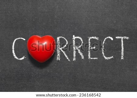 correct word handwritten on chalkboard with heart symbol instead of O