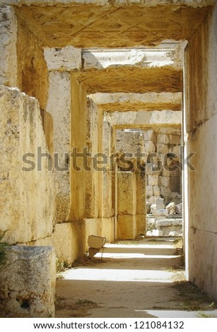 Corridor among columns of the old lock in Lebanon - stock photo