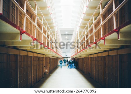 Corridor in an abandoned Penitentiary - stock photo