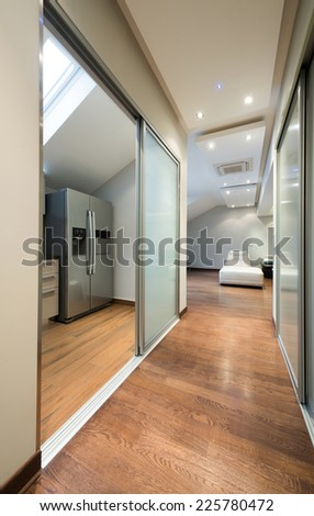 Corridor in luxury apartment with view to a kitchen
