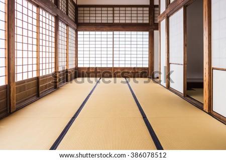 corridor of tatami mats and paper sliding doors called Shoji in Japanese  - stock photo