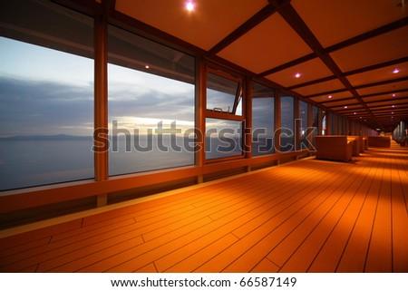 corridor on cruise ship. row of lamps. beautiful view  through window. - stock photo