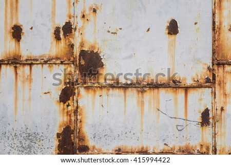 Corroded white metal background. Rusted white painted metal wall. Rusty metal background with streaks of rust. Rust stains. The metal surface rusted spots. - stock photo