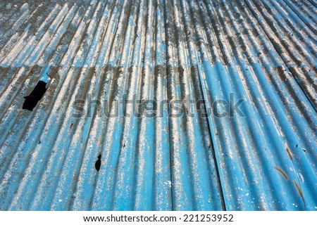 Corrugated blue asbestos ceiling panels - stock photo