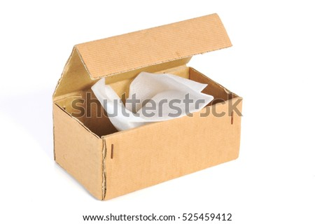 corrugated cardboard or brown paper package box open with foam shockproof isolated on white background