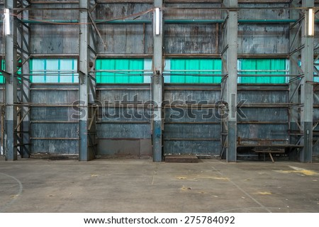 Corrugated iron wall in a warehouse. - stock photo