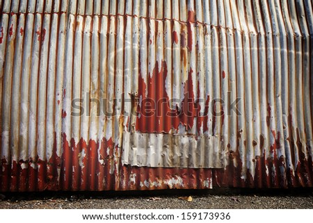 Corrugated metal with chipping red paint for urban style background. - stock photo