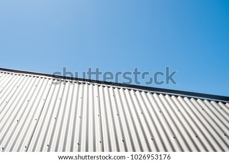 Corrugated steel roof against clear blue sky
