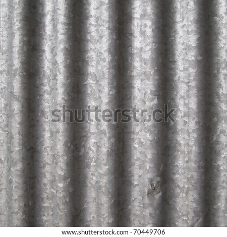 Corrugated steel sheet useful as a background