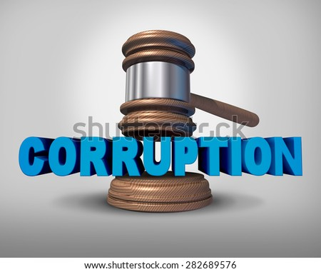 Corruption concept as a justice judge gavel or mallet coming down on the words that represent the criminal act of bribery and fraud as a legal metaphor for dishonest immoral behavior. - stock photo