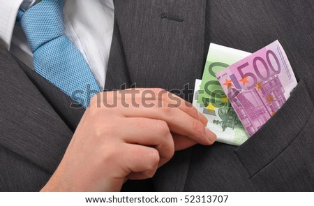 Corruption Concept, Corrupted Businessman Putting Euro Money Banknotes in Pocket. - stock photo