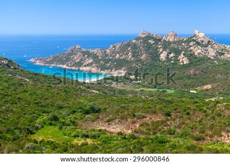 Corsica, coastal landscape with mountains and beach. Mediterranean Sea coast, France - stock photo