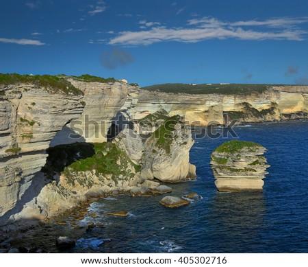 Corsica in sight, cliff near Bonifacio. Bonifacio is old town at sea cliff, Corsica, France - stock photo
