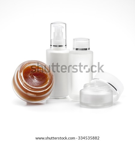 Cosmetic and beauty products in bottles on a white background - stock photo