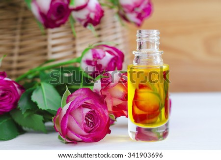 Cosmetic aroma oil with rose essence - stock photo