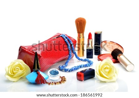 Cosmetic bag, jewelry, cosmetics, perfume and flowers in still life