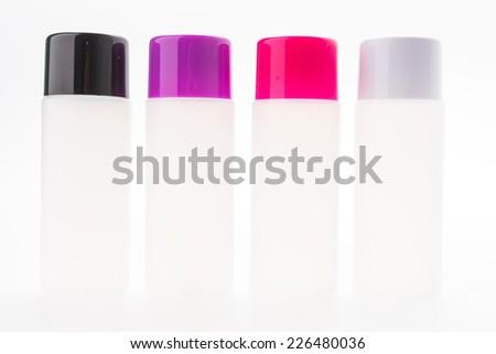 Cosmetic bottle isolated on white - stock photo