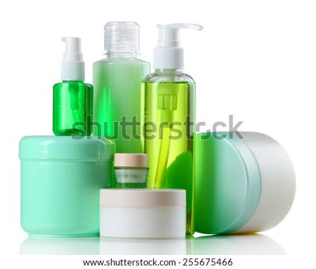 Cosmetic bottles on white background - stock photo