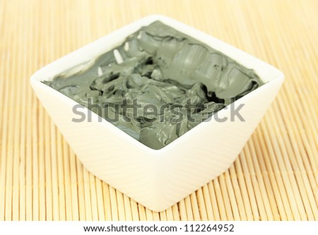 Cosmetic clay in white bowl close-up - stock photo