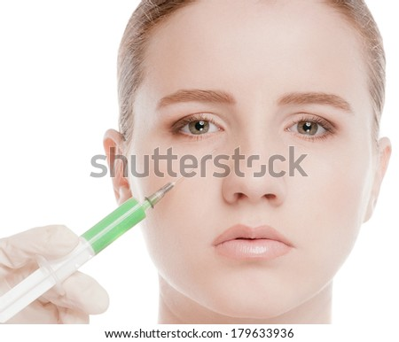 Cosmetic correction injection in the female face. Eye and eyebrow zone. Isolated on white