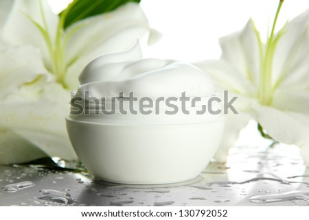 Cosmetic cream and beautiful lily, close up - stock photo