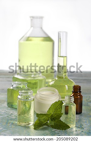 Cosmetic Face Cream , essential oils and fragrance of peppermint  - stock photo