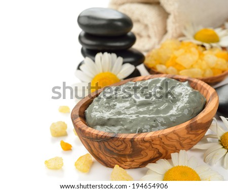 Cosmetic green clay on a white background - stock photo