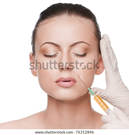 Cosmetic injection in the female face. Lips zone. Isolated - stock photo