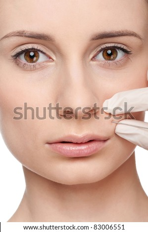 Cosmetic injection in the female face. Lips zone, Isolated