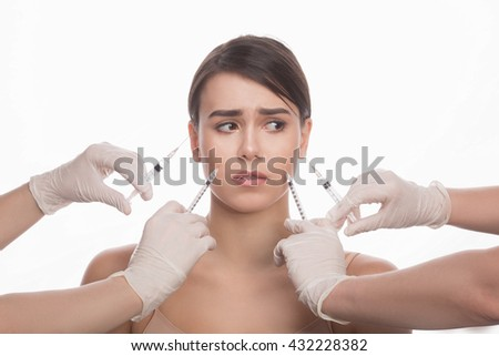 Cosmetic injection in the spa salon. Beautician makes injection into patient's face. Beauty injections, mesotherapy, revitalization, cosmetic medicine injection. Concept of rejuvenation. - stock photo