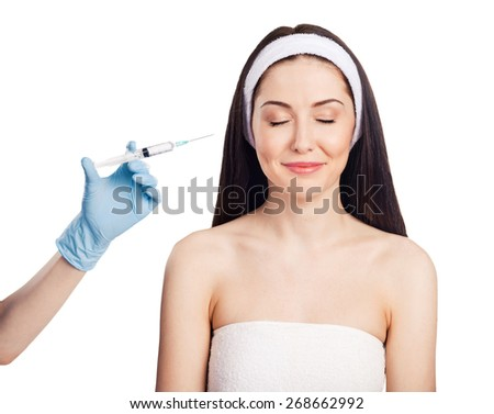 Cosmetic injection in the young woman face. Isolated on white background - stock photo