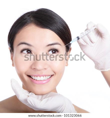 Cosmetic injection in woman face. Eye zone. Isolated on white background, model is a asian beauty - stock photo