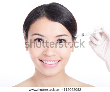 Cosmetic injection surgery to the pretty woman face isolated on white background, model is a asian beauty - stock photo