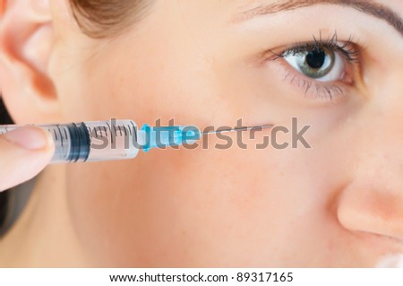 cosmetic injection  to the face of beautiful woman - stock photo