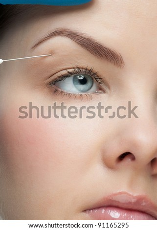 Cosmetic injection to the pretty female face. Isolated on white background - stock photo