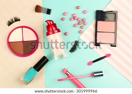 Cosmetic on colorful paper background - stock photo