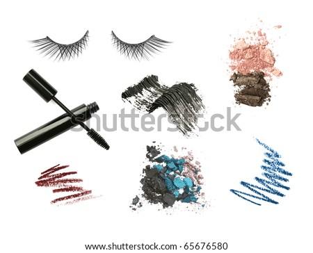 Cosmetic products isolated on white background. Mascara, pencils, lashes, eyeshadow, strokes - stock photo