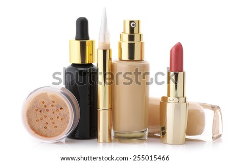 Cosmetic set: liquid foundation, concealer, mineral powder, lipstick and face serum isolated on white background. - stock photo