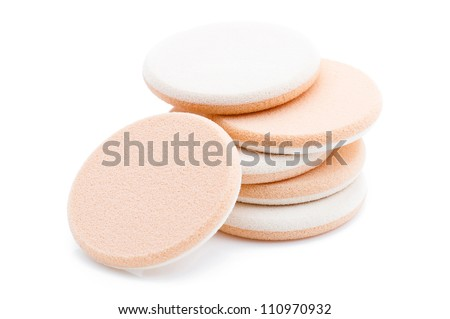 Cosmetic sponges on white background - stock photo