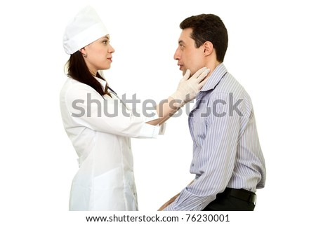 cosmetic surgeon and patient on white background - stock photo