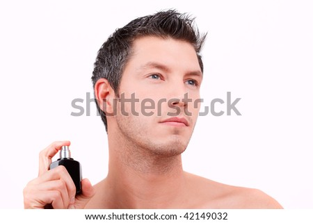 Cosmetic wellness spa man spraying fragrance - stock photo