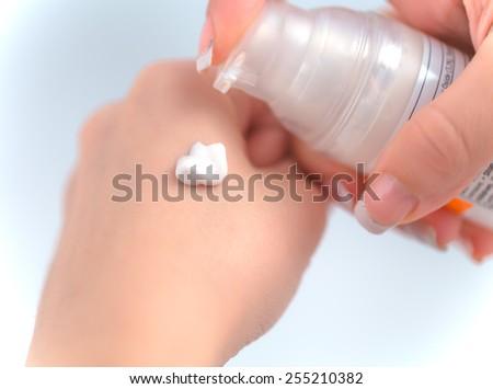Cosmetics, beauty, care, cream, hands, pomp. - stock photo